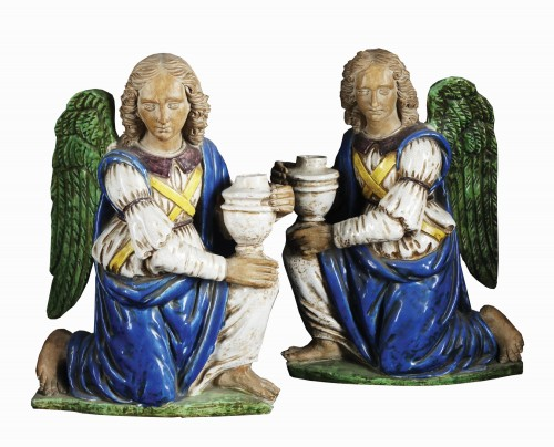 Pair of glazed terracotta torchère-bearing angels after Benedetto Buglioni
