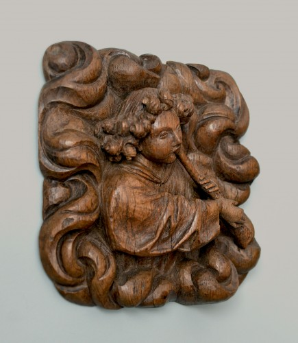 Sculpture  - A superbly carved 15th century wood relief of an angel blowing a shawm