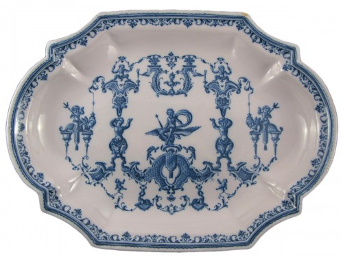 Large dish with berain decoration - Moustiers 18th century