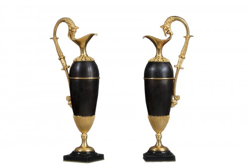 Pair Of Jugs With Griffin Head Handles
