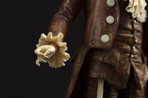 - Pair of 19th century ivory and wood sculptures