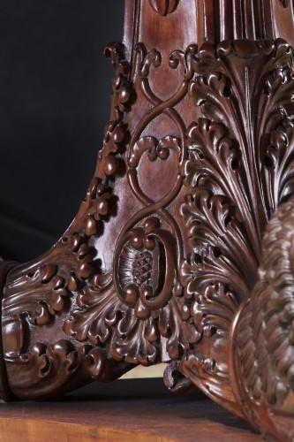 An Antique Mahogany Center Table -
