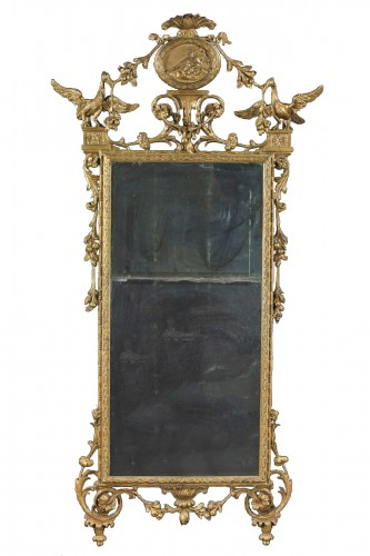 Large tuscan mirror in gilded and carved wood