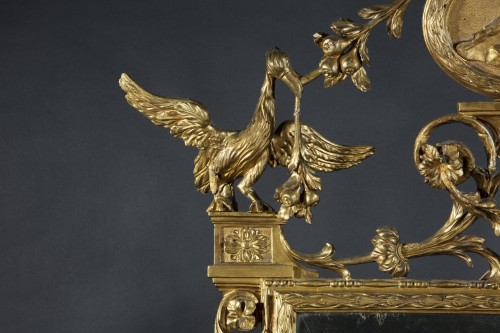 Large tuscan mirror in gilded and carved wood -