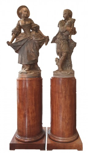 "Terracotta sculptures depicting "" the bagpiper""and "" the dancer"""