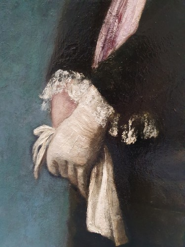 Portrait of a young woman with a mauve bib -