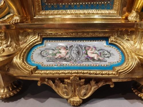 "so-called ""romantic"" clock adorned with Sèvres porcelain plaque -"