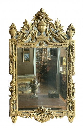 Louis XVI period mirror in gilded wood