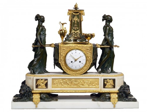 A Louis XVI mantel clock of Vestal Virgins Carrying the Sacred Fire
