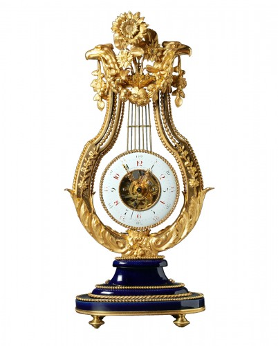 Louis XVI gilt bronze and Sèvres porcelain skeletonised lyre clock