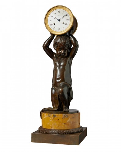A figural clock signed on the flat silvered Breguet