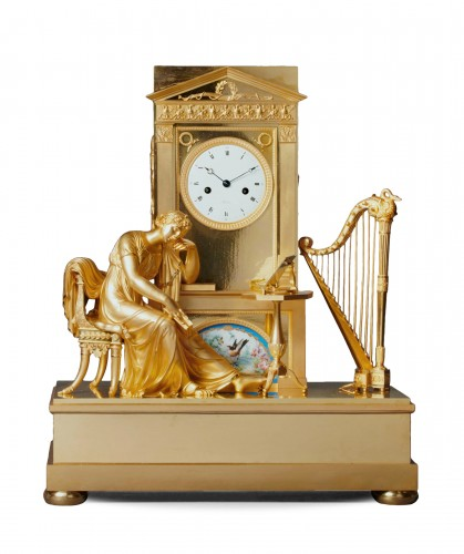 An Empire gilt bronze mantel clock with a Paris porcelain by Boileau