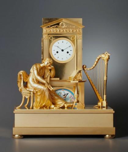 An Empire gilt bronze mantel clock with a Paris porcelain by Boileau - Horology Style Empire