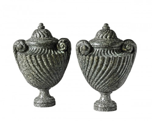 A pair of Louis XVI serpentine covered vases
