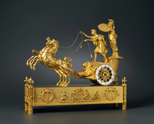 An Empire gilt bronze chariot clock of eight day duration housed  - Horology Style Empire