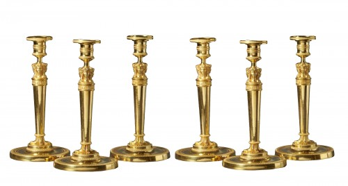 A set of six Empire gilt bronze figural candlesticks