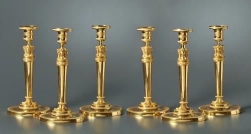 Lighting  - A set of six Empire gilt bronze figural candlesticks