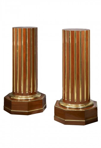 A pair of Empire Russian gilt bronze mounted carved and gilded columns