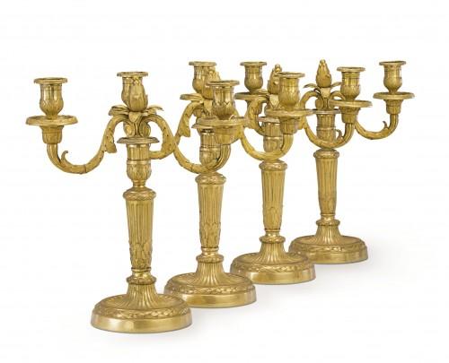 A set of four Louis XVI gilt bronze two-light candelabra after Delafosse - Lighting Style Louis XVI