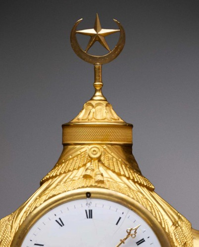 An Empire gilt bronze pendule 'au dromadaire' by Basile-Charles Le Roy -
