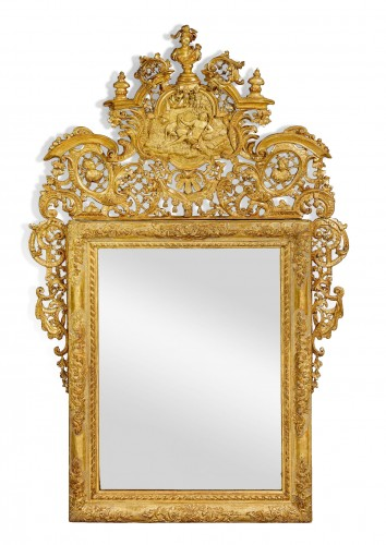A Venetian Baroque carved giltwood ceremonial mirror