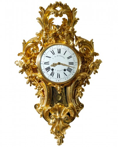 A Louis XV gilt bronze cartel clock by Jean-Baptist II Dutertre