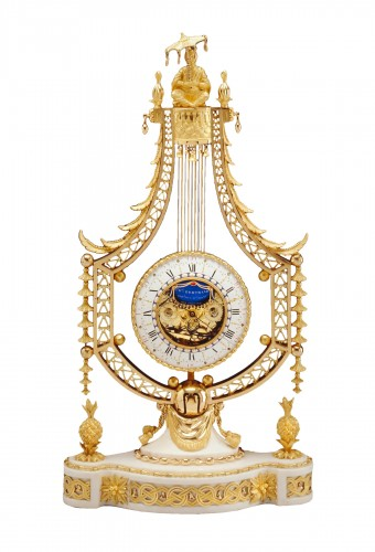 A Louis XVI lyre clock by Joseph-Charles-Paul Bertrand