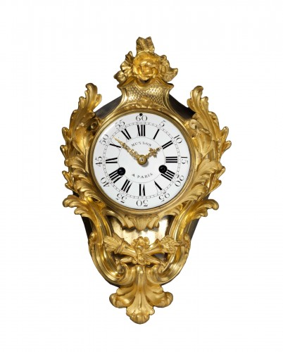 A late Louis XV gilt bronze clock by Pierre Musson