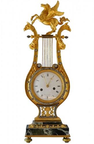 A Louis XVI lyre clock, signed by Manière à Paris