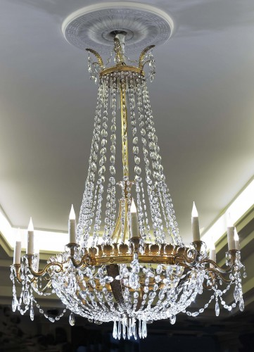 An Empire gilt bronze and cut-glass twelve-light chandelier