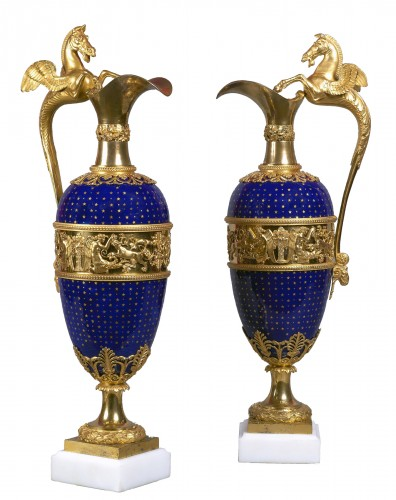 A pair of Louis XVI gilt bronze mounted blue enamel ewers