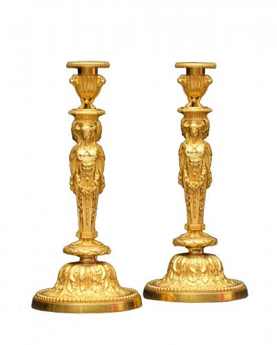 A pair o bronze candlesticks circa 1820 after a model by Jean-Démosthène Dugourc