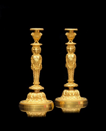 A pair o bronze candlesticks circa 1820 after a model by Jean-Démosthène Dugourc - Lighting Style Restauration - Charles X