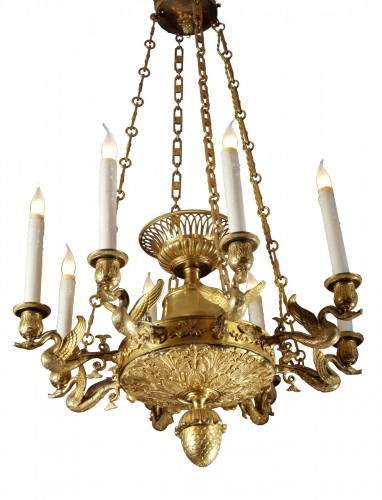 An Empire eight-light chandelier with eight swan-neck branches