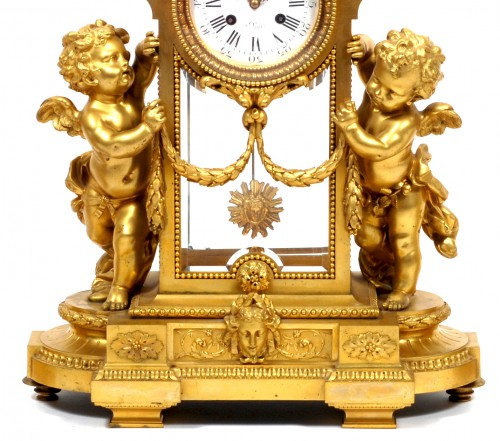 Victor Paillard (1830 - 1886) - Gilt-bronze three piece clock garniture -