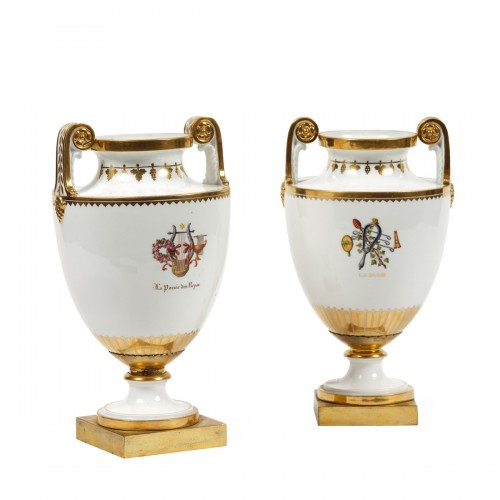 Pair of 19th century Sèvres porcelain vases with attributes