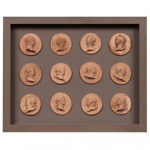 Twelve Caesars in terracotta medallions  - French or Italian school c. 1800