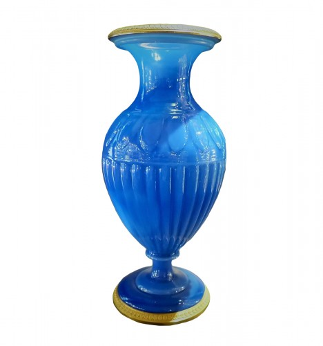 Opaline of blue color and gilded  bronze vase