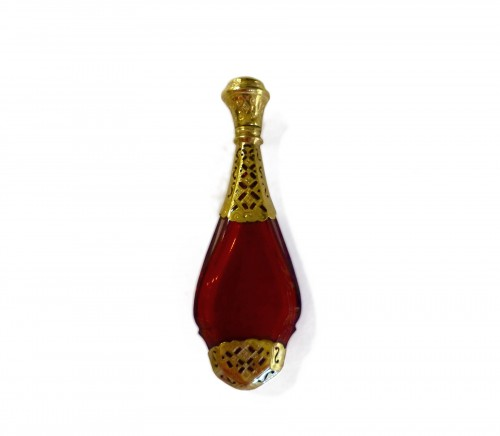 Red and gold crystal bottle