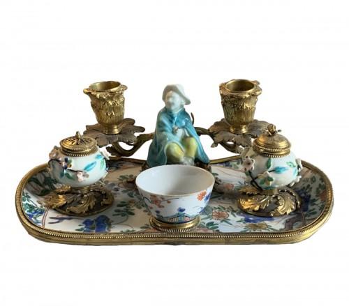 An ormolu mounted porcelain inkstand
