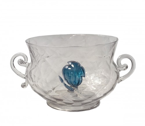 A faceted bowl with handles and a blue gadrooned bulb in the centre