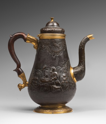 A gilt and patinated copper coffee pot -