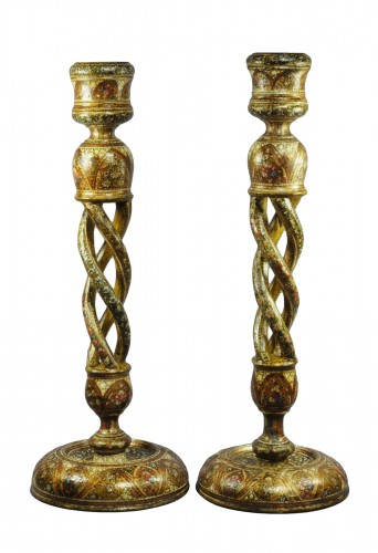 A pair of large Indian Kashmir lacquered open twist candlesticks