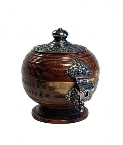 An Indo-Portuguese silver mounted turned ivory spherical box