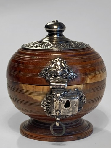 An Indo-Portuguese silver mounted turned ivory spherical box -