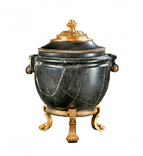An ormolu mounted black marble antique vase with Régence mounts