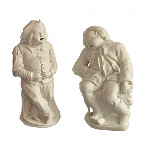 A pair of 18th century biscuit porcelain figures for a centerpiece