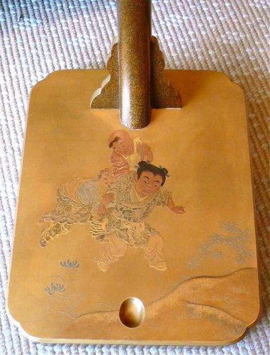 Asian Art & Antiques  - A Gold Lacquer katana holder or Tachi Kake