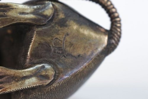 - Japanese Bronze of a Small Rat Holding a Chestnut.
