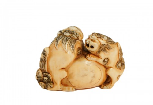 Ivory Netsuke of 2 shishi the Paws on a ball